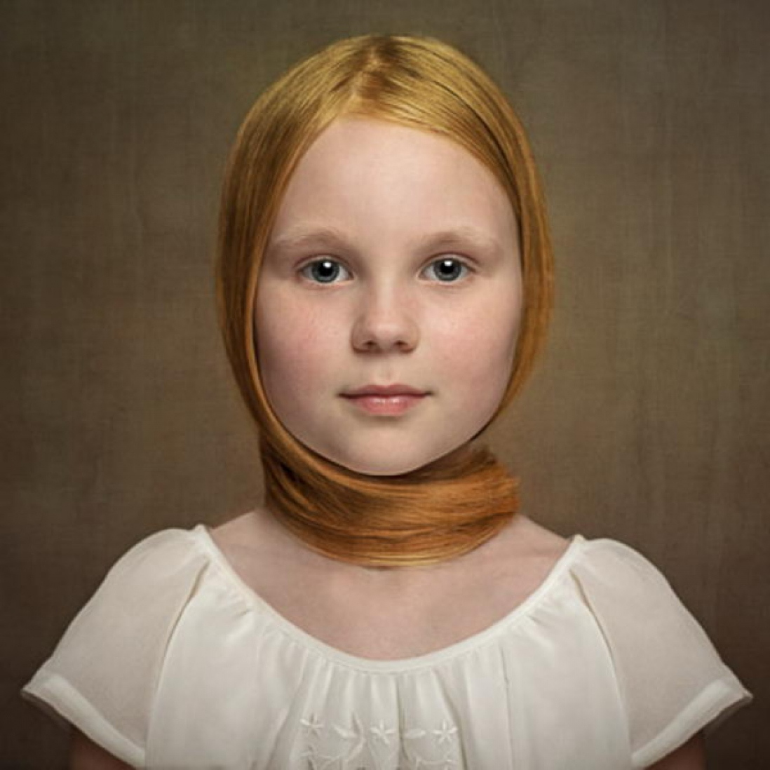 Photograph of young girl wearing simple white top, with orange-red hair combed down and wrapped around neck as ornament.