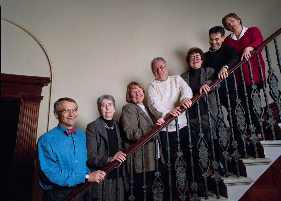 Group of people standing on staircase. Jack is in white shirt in centre of image.