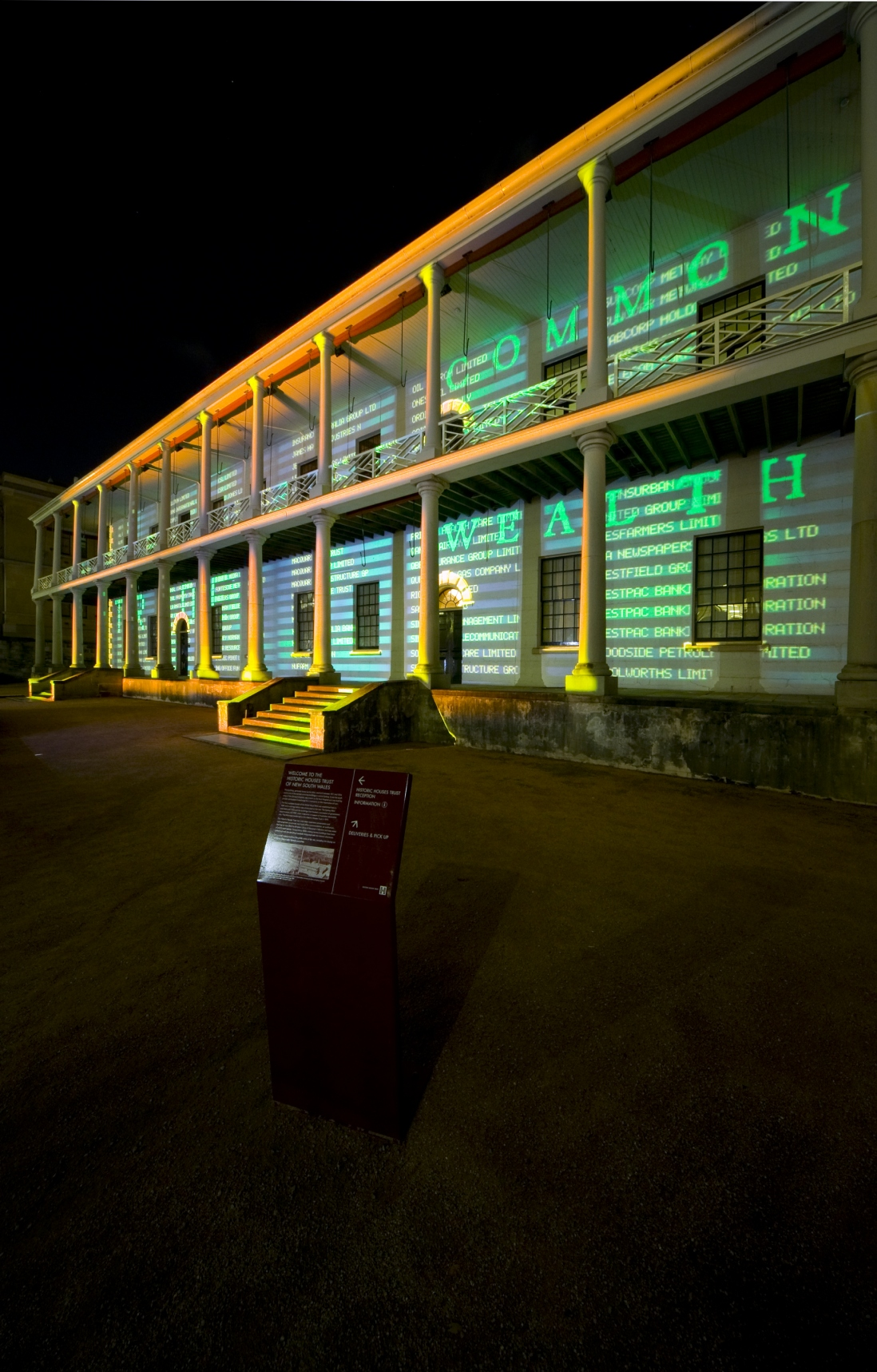 The facade of the Mint building covered in projected coloured lights