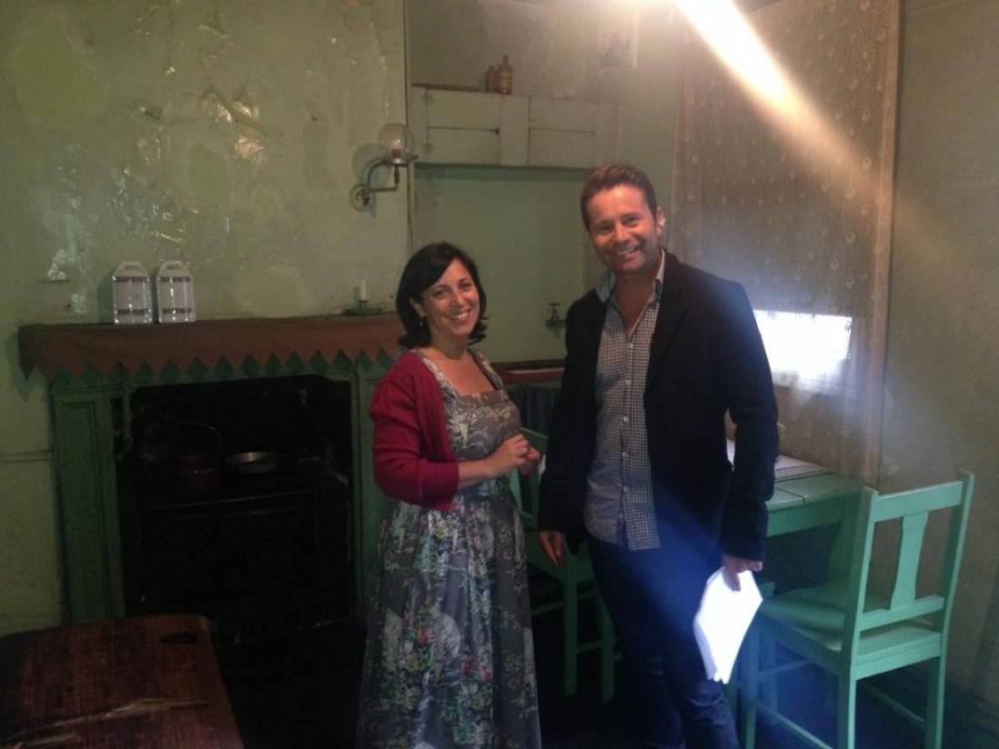 Curator Anna Cossu with weather man Stevie Jacobs at Susannah Place Museum
