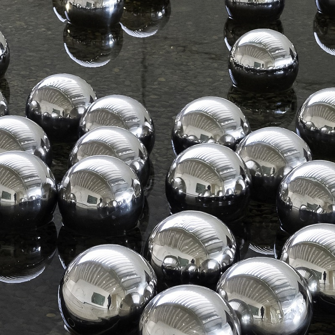 A group of reflecting mirrored balls.