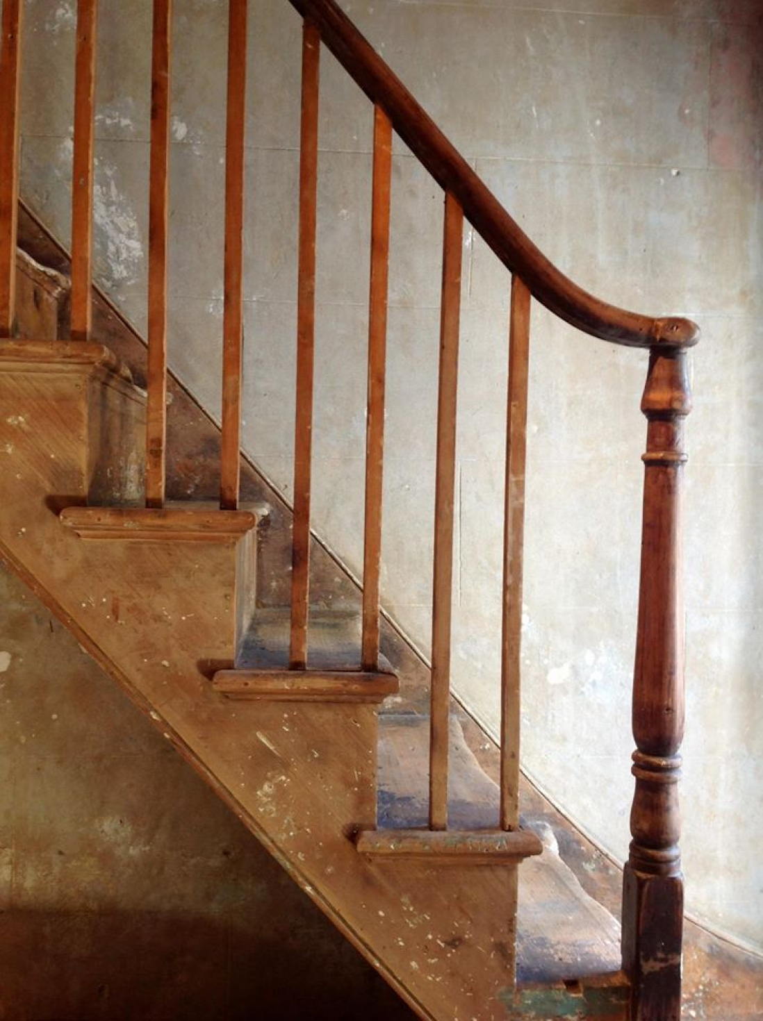 Restored staircase and wall inside shop.