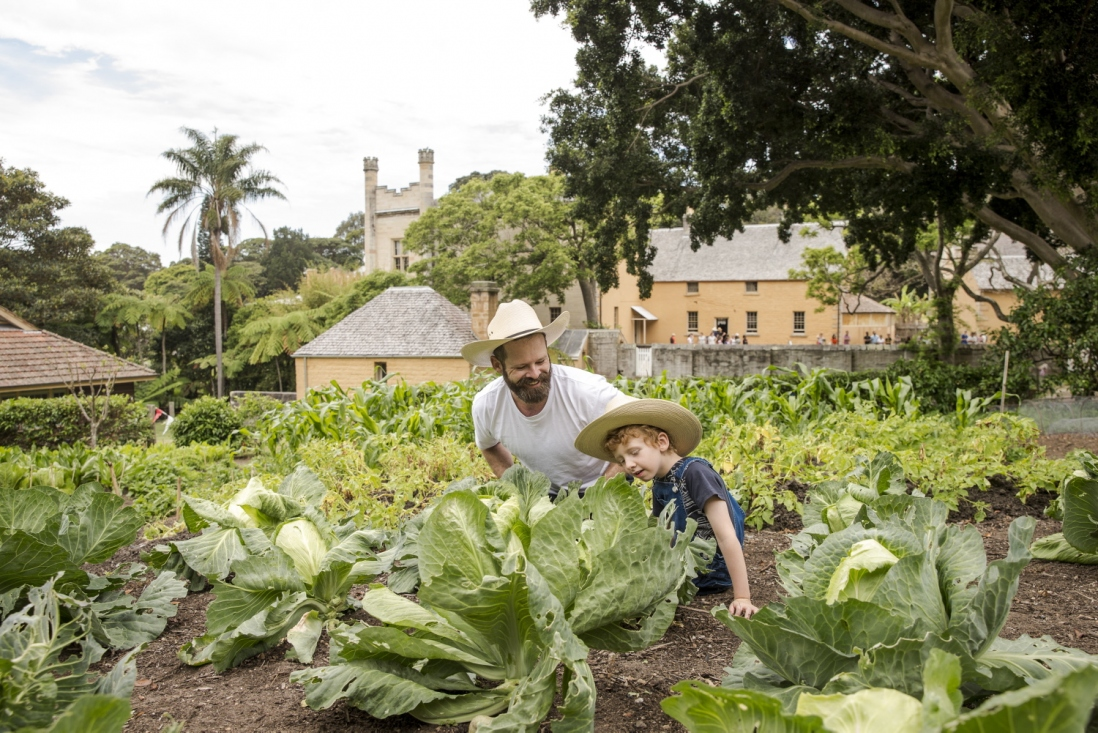 Photograph of a man and boy in a garden