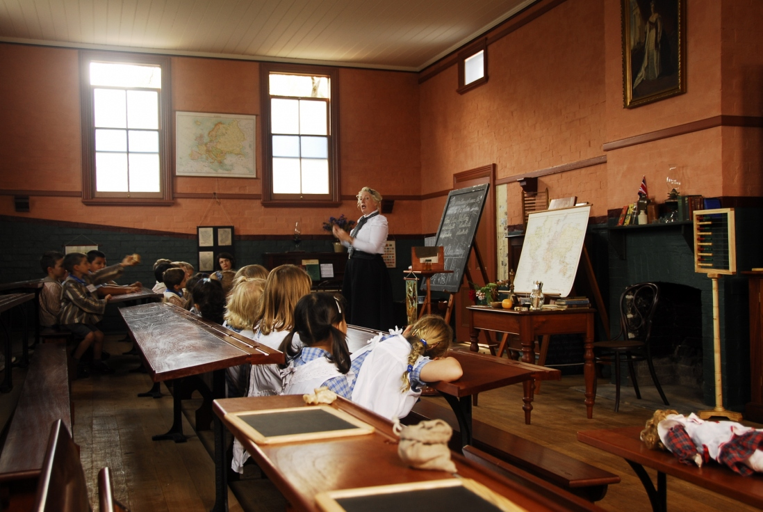 Teacher and children in the schoolhouse