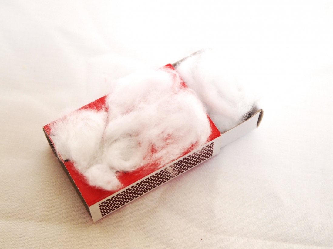 Matchbox covered with cottonwool, also with cottonwool inside.