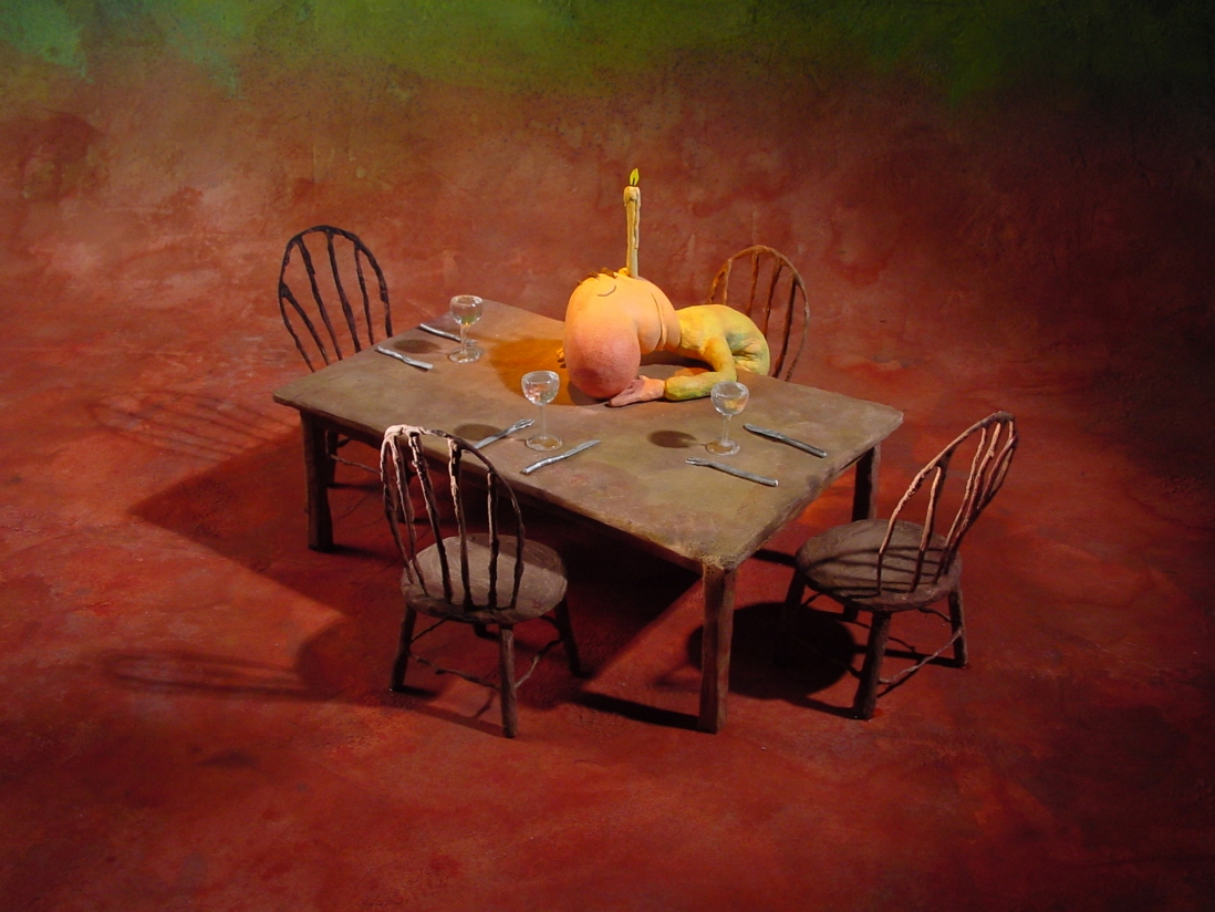 A leunig character sits sleeping at a dinner table with a candle in his ear