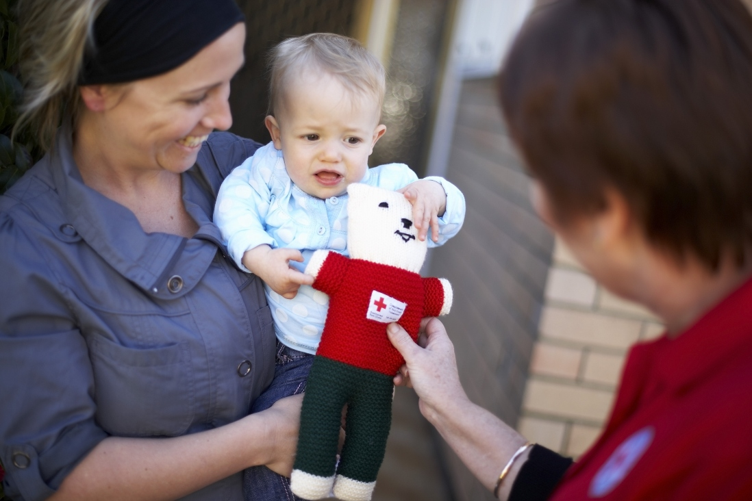 Two women and a baby and a knitted Trauma Teddy