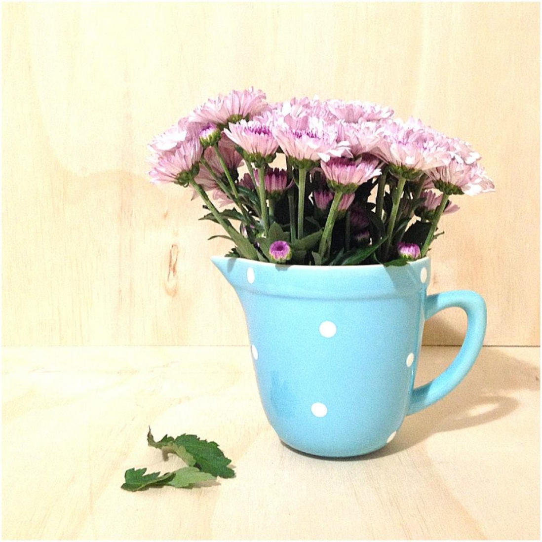 Image of a blue jug with flowers