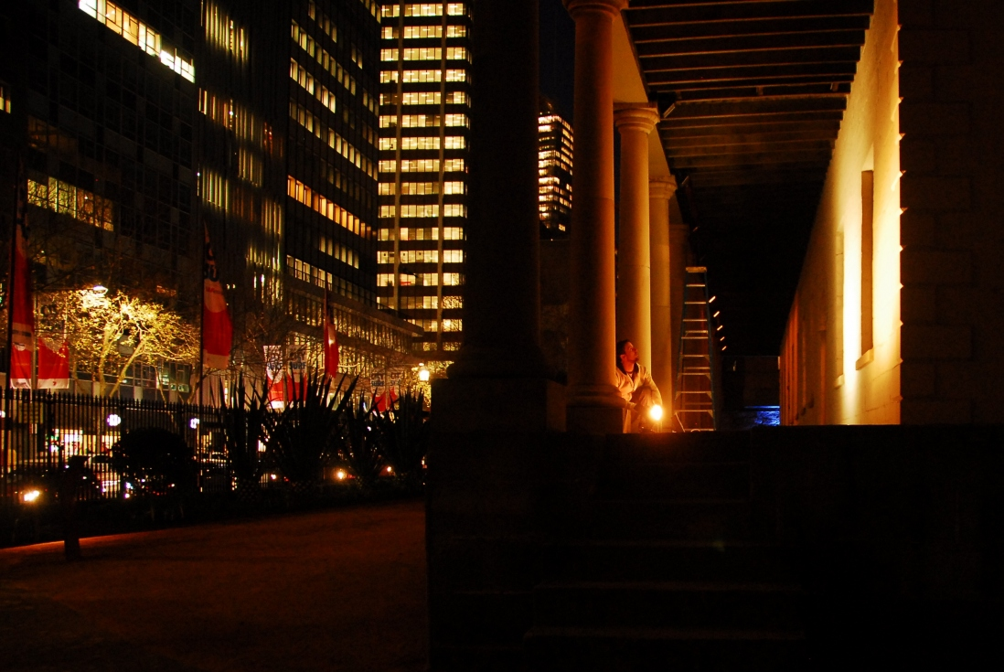 Night time view of front verandah of building with lighting and street lighting in background on Macquarie Street Sydney.
