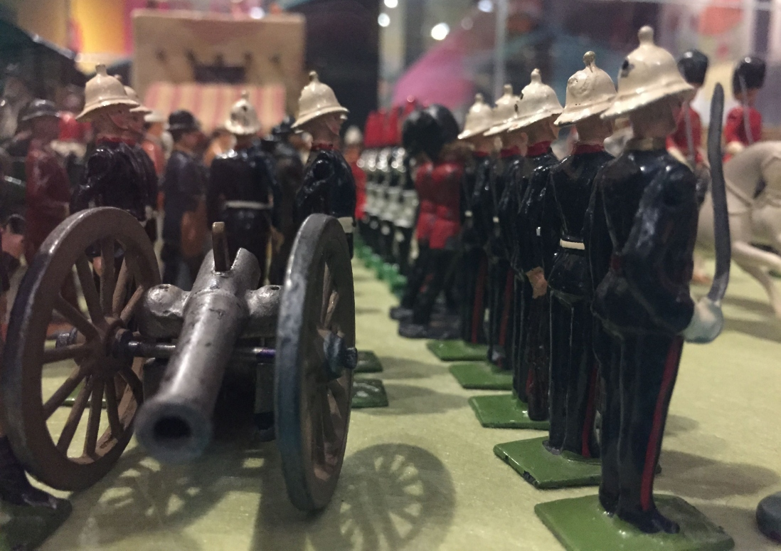 This is a colour photograph of rows of lead soldiers on display