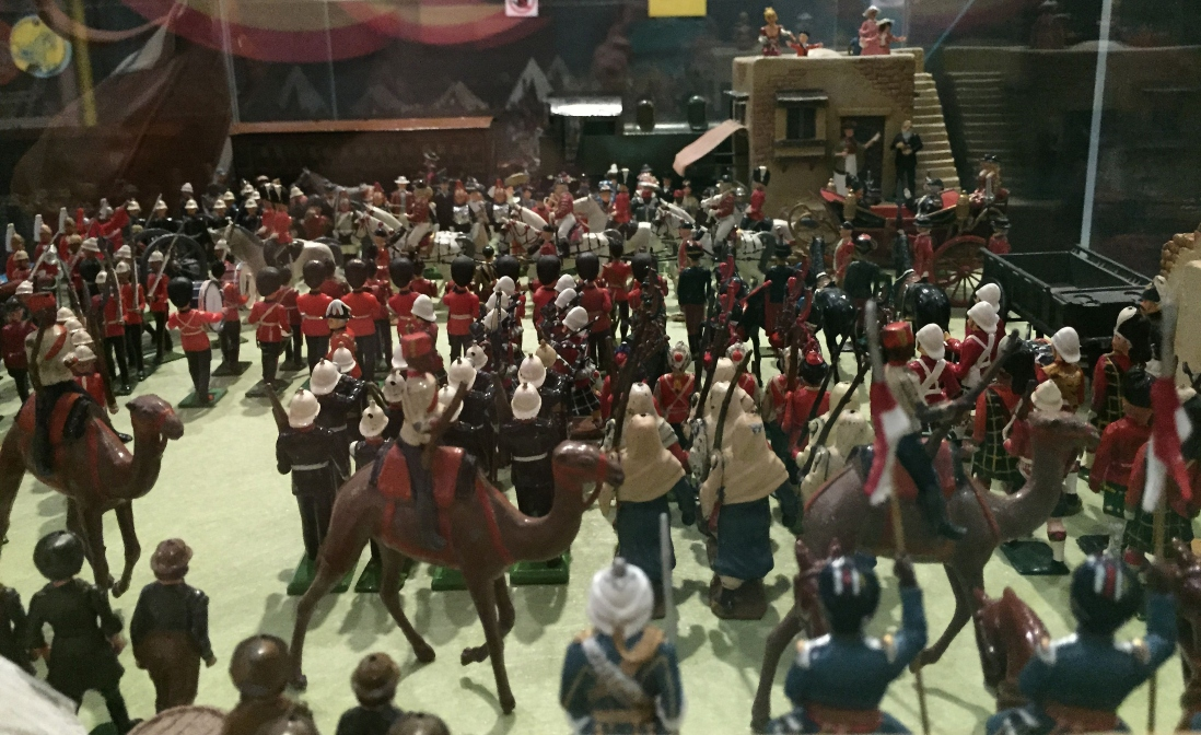 This is a photograph of a display of toy soldiers including camels