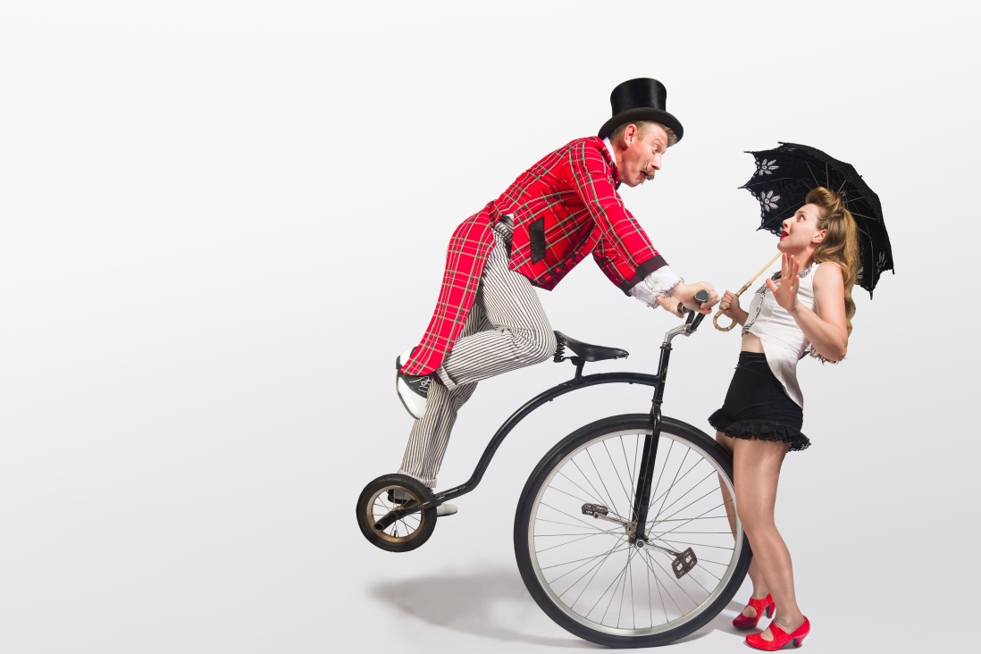 Man and woman with a penny farthing bike