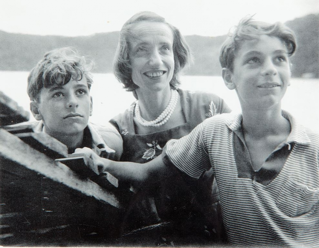 Black and white photograph of a woman with two boys.