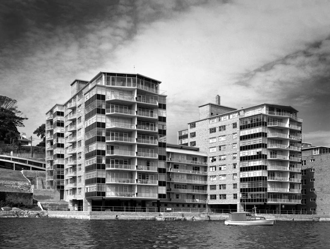 Black and white photograph of an apartment building.