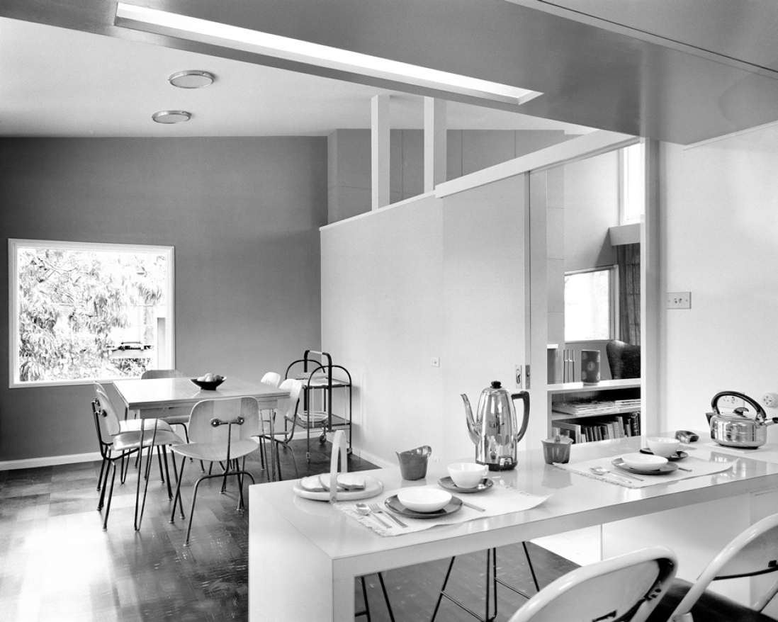 Black and white photograph of a house interior.