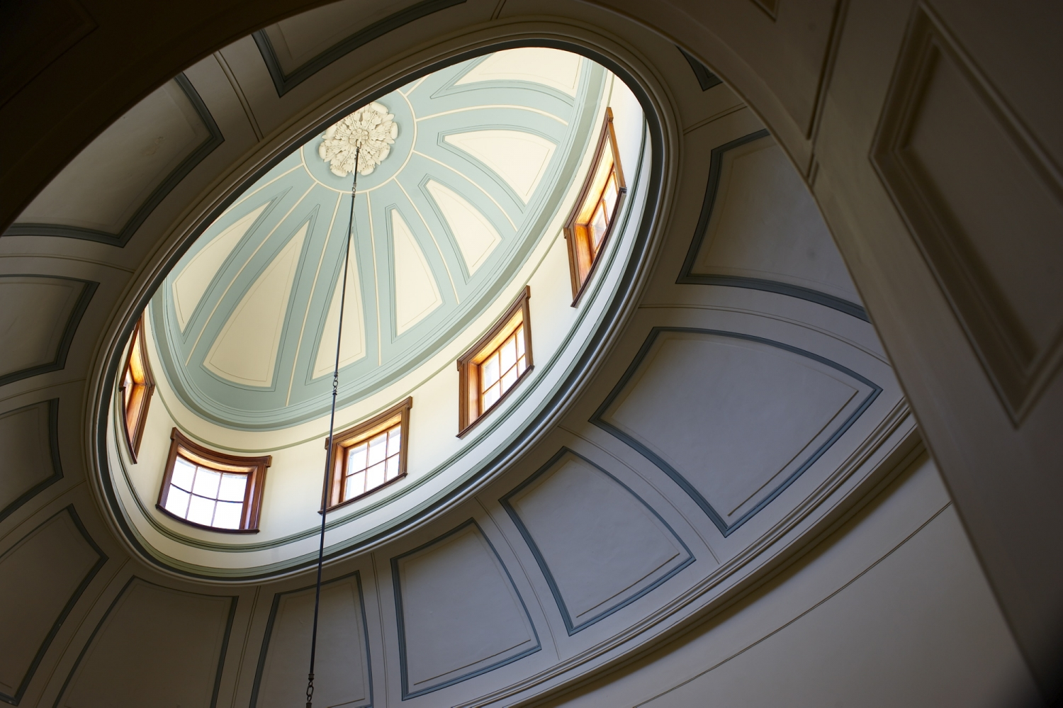 Looking up into naturally lit oval shaped dome.