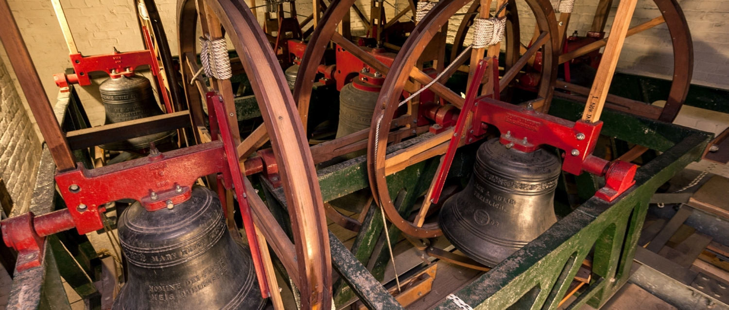 Bells with ringing mechanisms visible