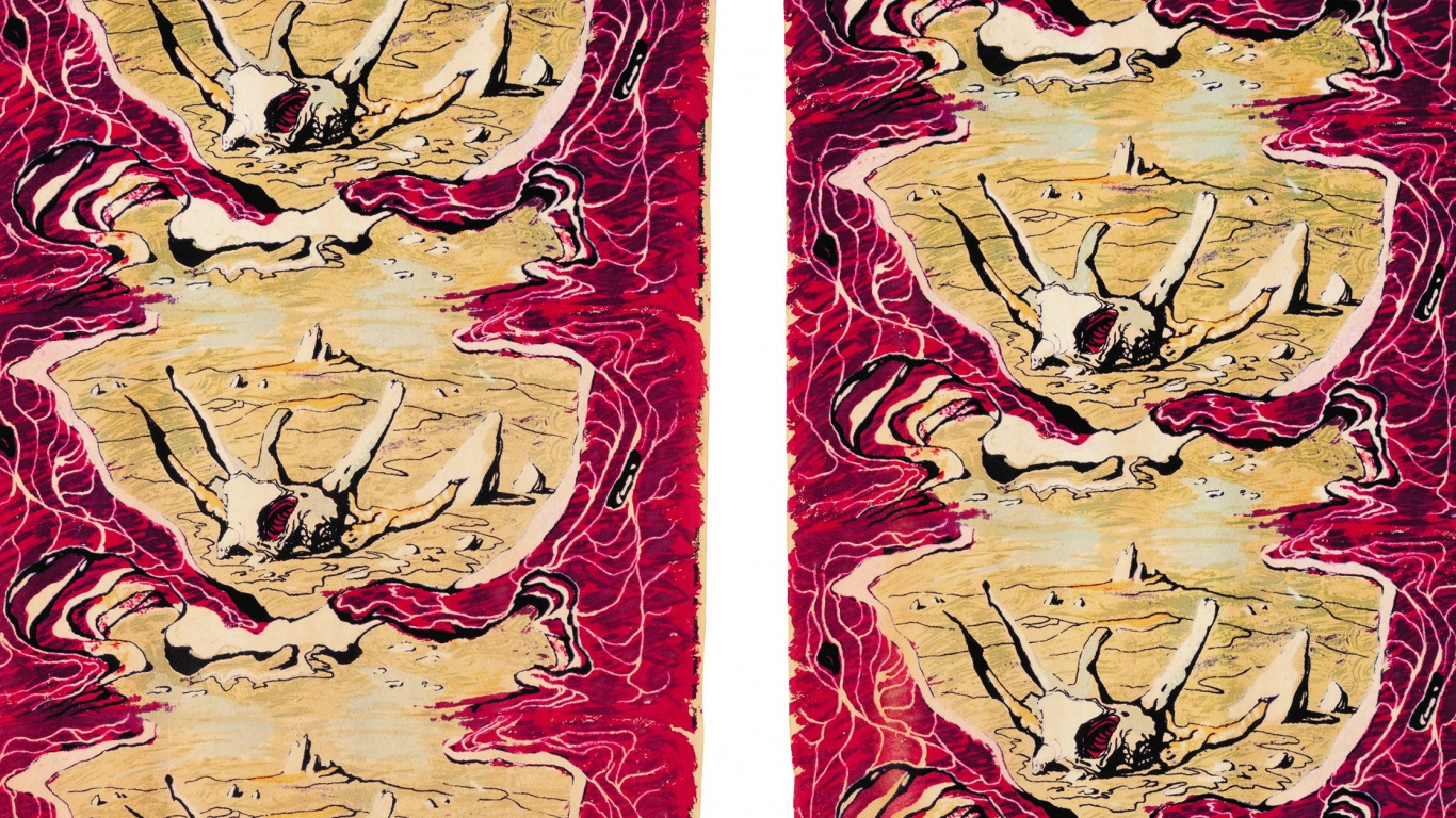 Detail view of pair of red curtains with repeated motif design down centre.