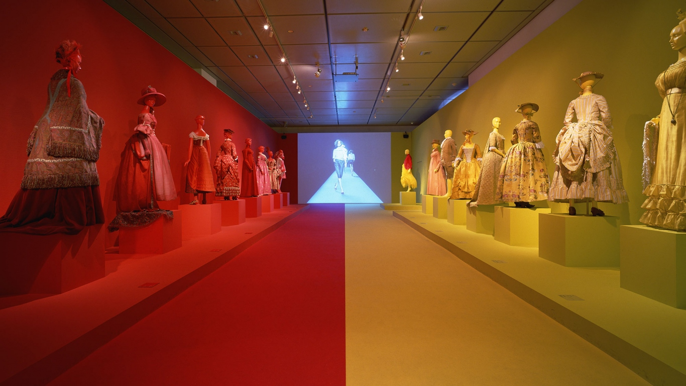 Exhibition of costumes with colouful lighting.