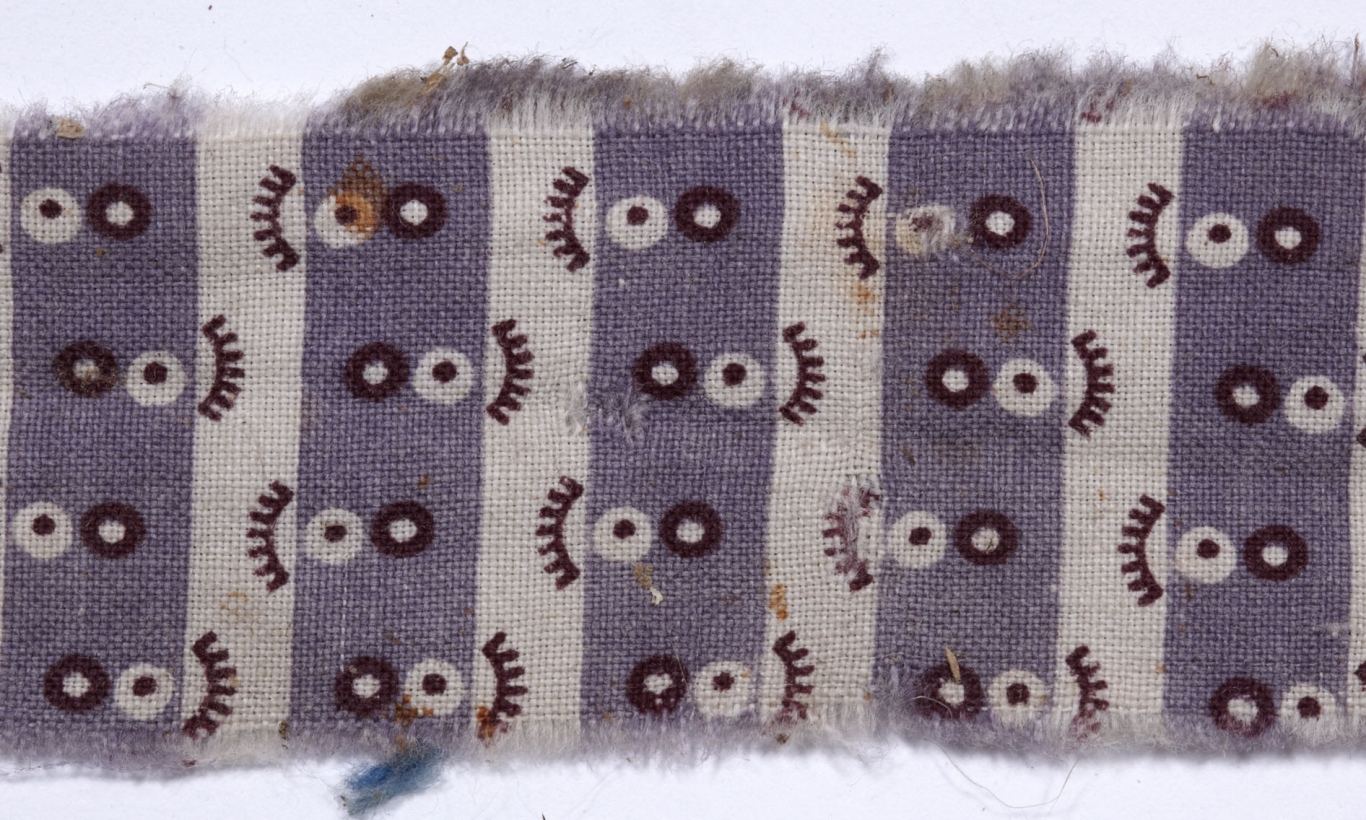 Fragment of purple patterned cloth.