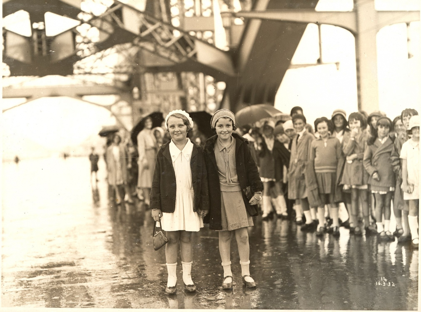 Two girls standing on the Sydney Harbour Bridge