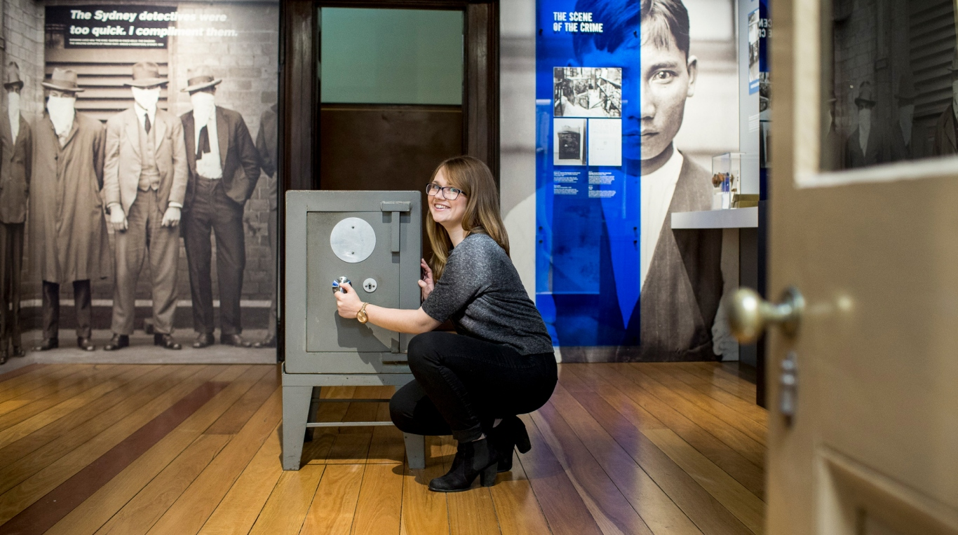 A woman trying to open a safe at the Justice and Police Museum