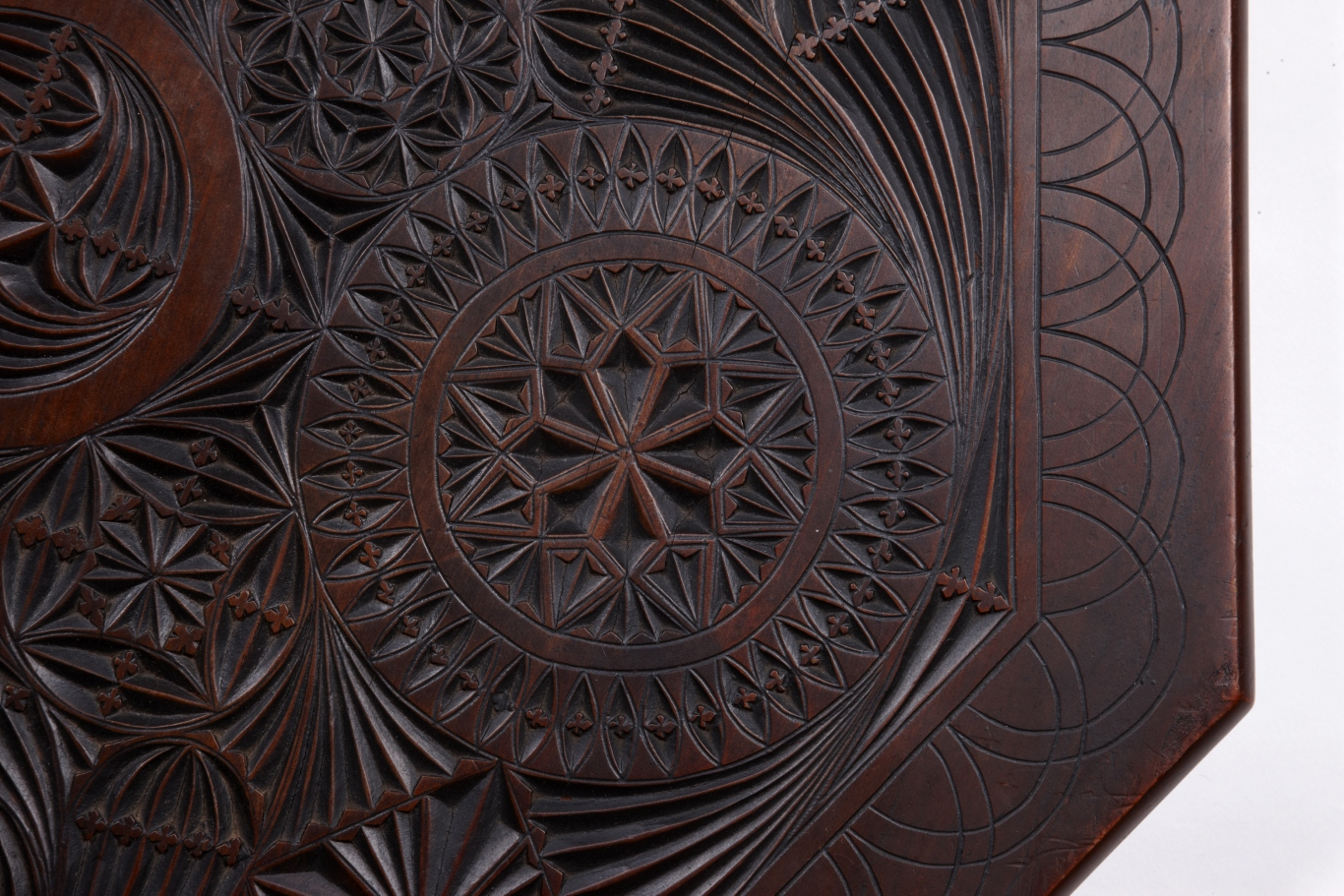 Detail of top of demountable, chip-carved occasional table made by carpenter George Stevenson Liggins