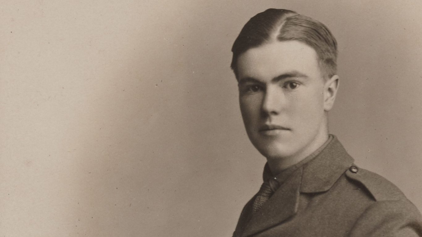 Head and shoulders portrait of soldier in uniform, with hair parted and oiled tightly down on the scalp.