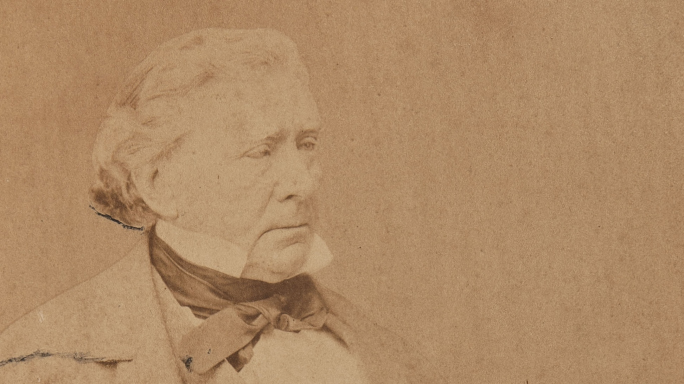 faded sepia toned head and shoulders portrait of William Charles Wentworth, looking to the right of the image.