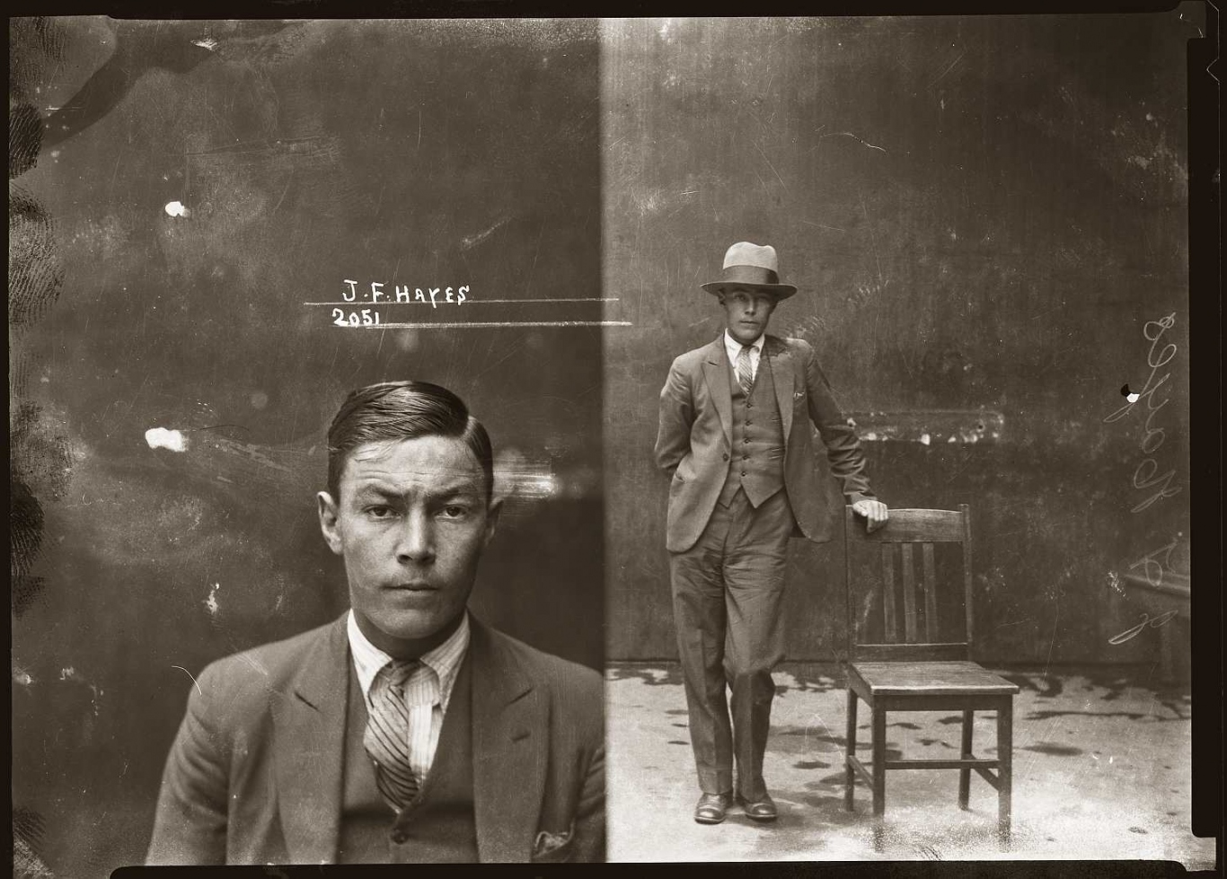 Old forensic archive image of Chow Hayes. The image on the negative is separated into two, the lift a head and shoulders and the right a full body shot with Hayes also wearing a hat and holding a chair. He is reading a three piece suit and tie.
