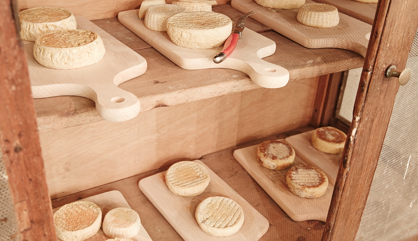 Cheese & wooden boards on shelves