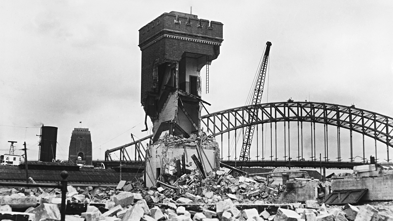 Demolished building in foreground, Harbour Bridge in background.