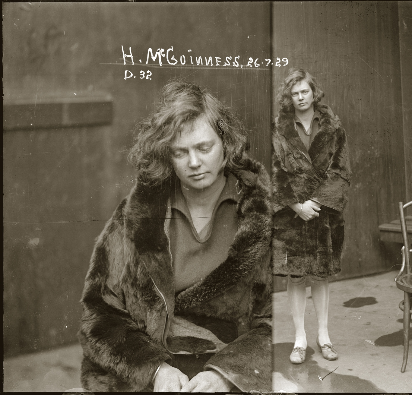 Two views of young woman dressed in fur coat. On the left she is closer to the camera and looking down, on the right she can be seen full length, showing pale stockings and shoes. The image is hand-inscribed 'H. McGuiness 26.7.29 D32'