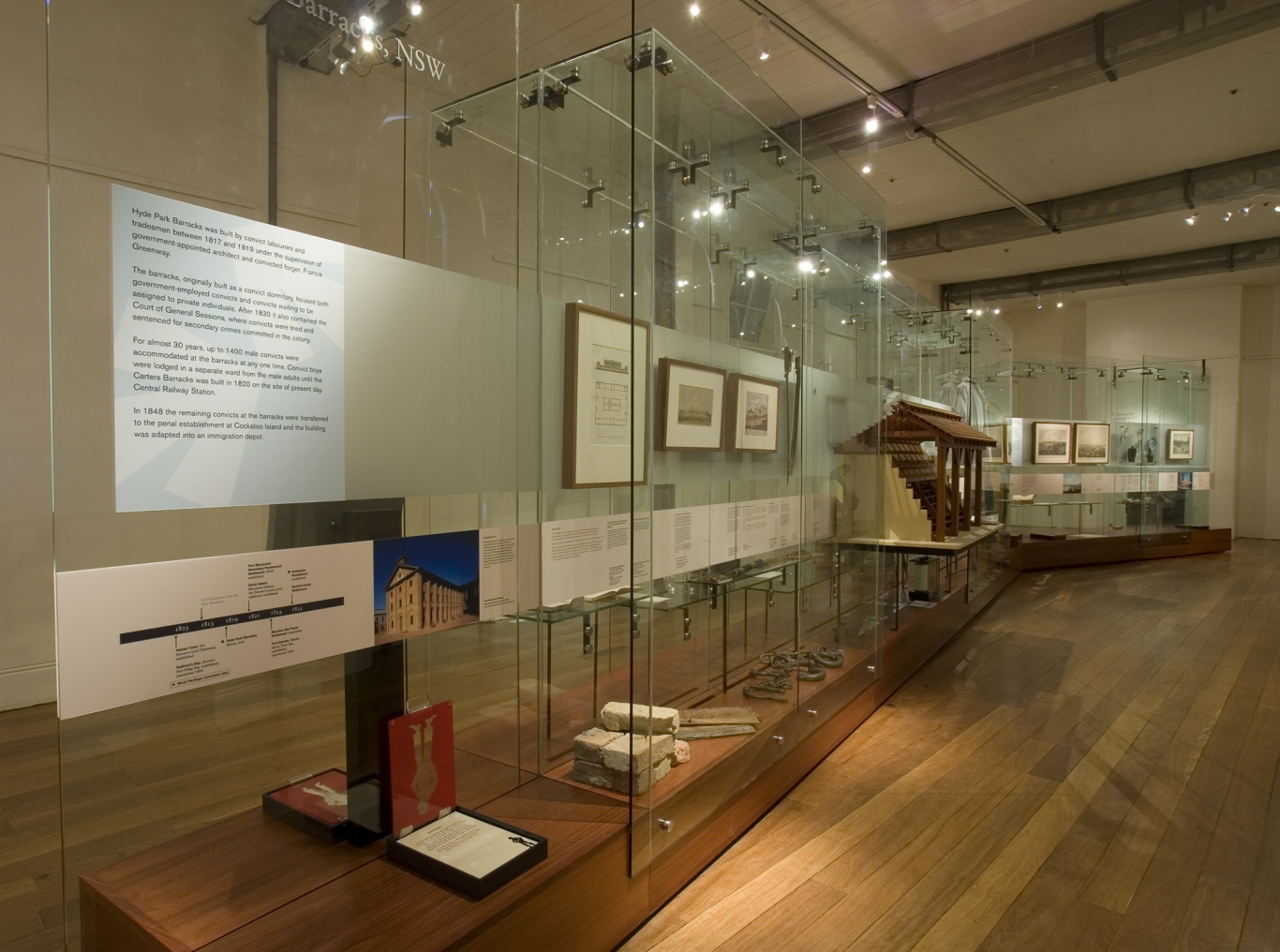 Documentation of Convicts: sites of punishment exhibition showing exhibition panel and objects