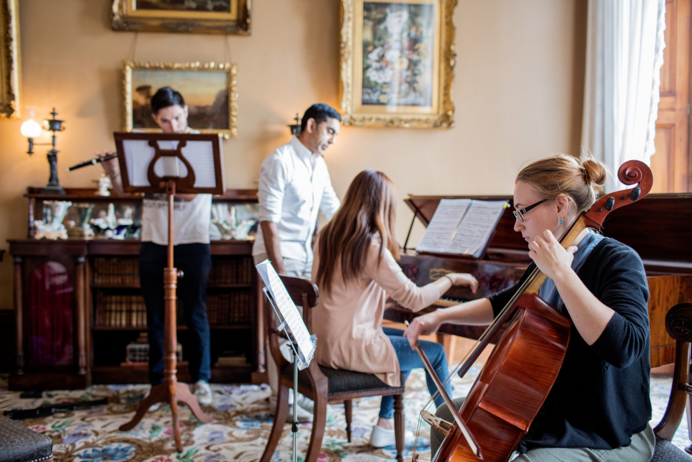 Theo Small (flute), Associate Professor Neal Peres Da Costa, Esther Kim (piano) and Jemma Thrussell (cello) from the Historical Performance Unit, Sydney Conservatorium of Music, in the drawing room at Elizabeth Bay House