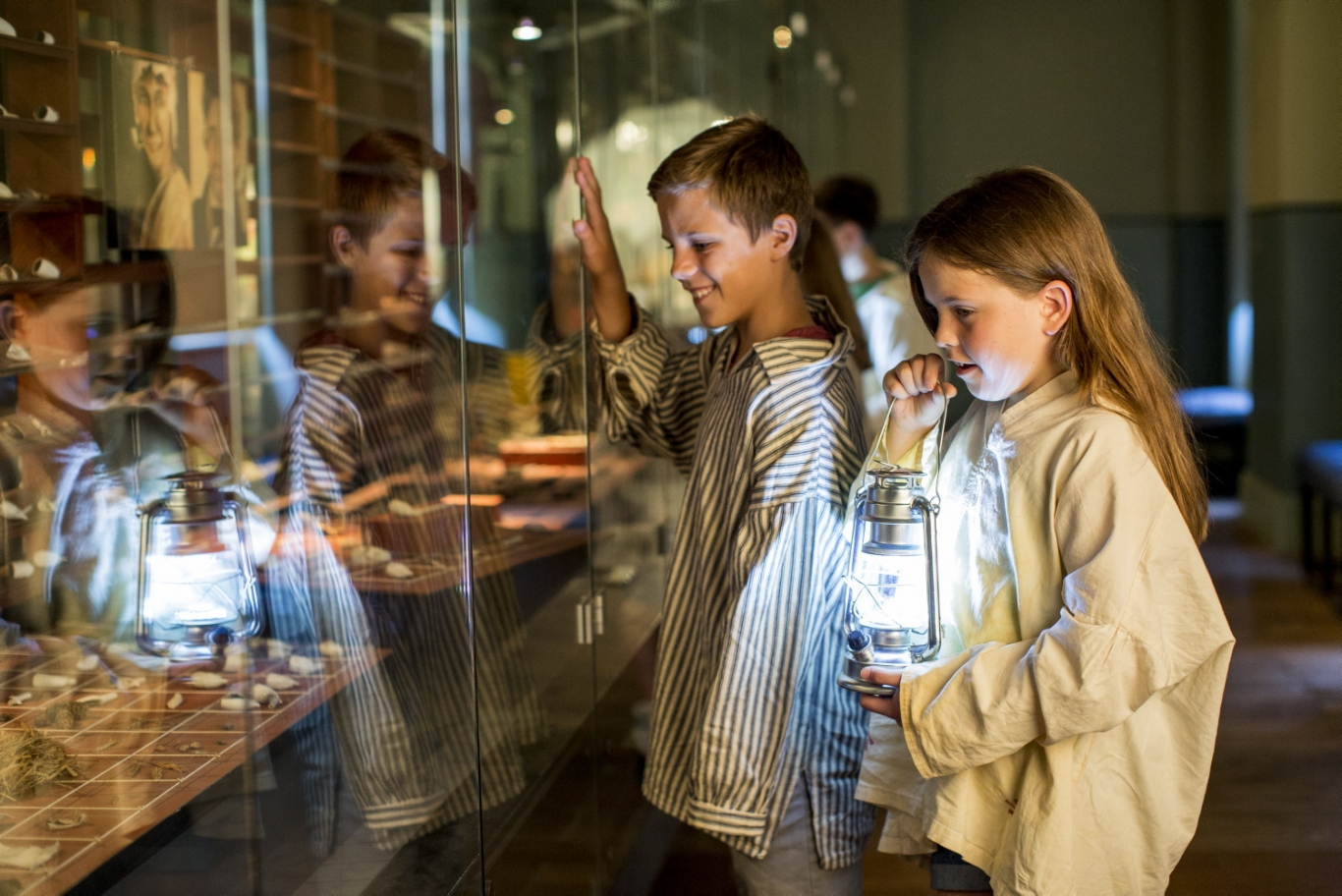 Children in convict garb look at a display at the Hyde Park Barracks Museums