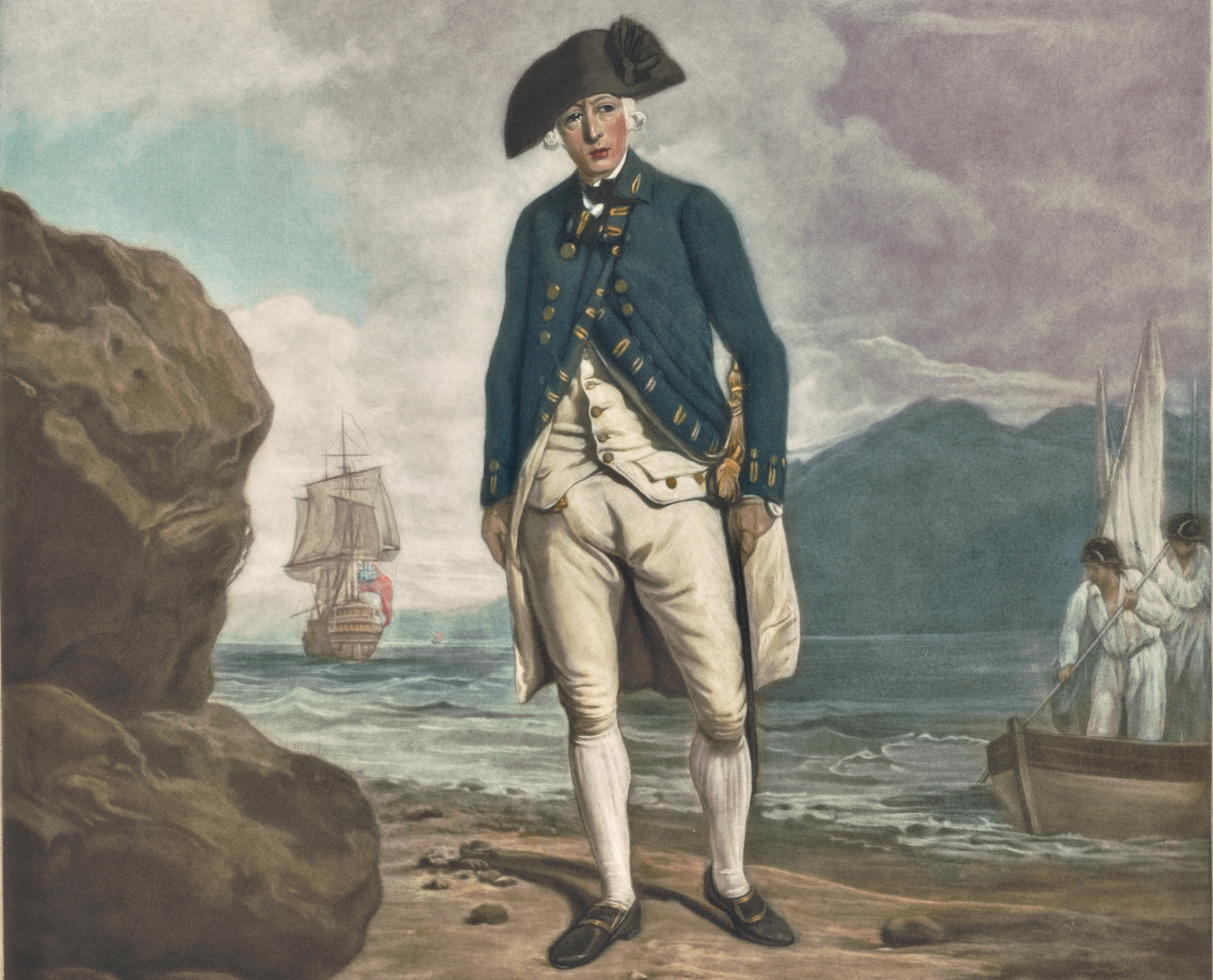 Portrait of man in uniform with black hat, standing on beach with ship and small boat in background.