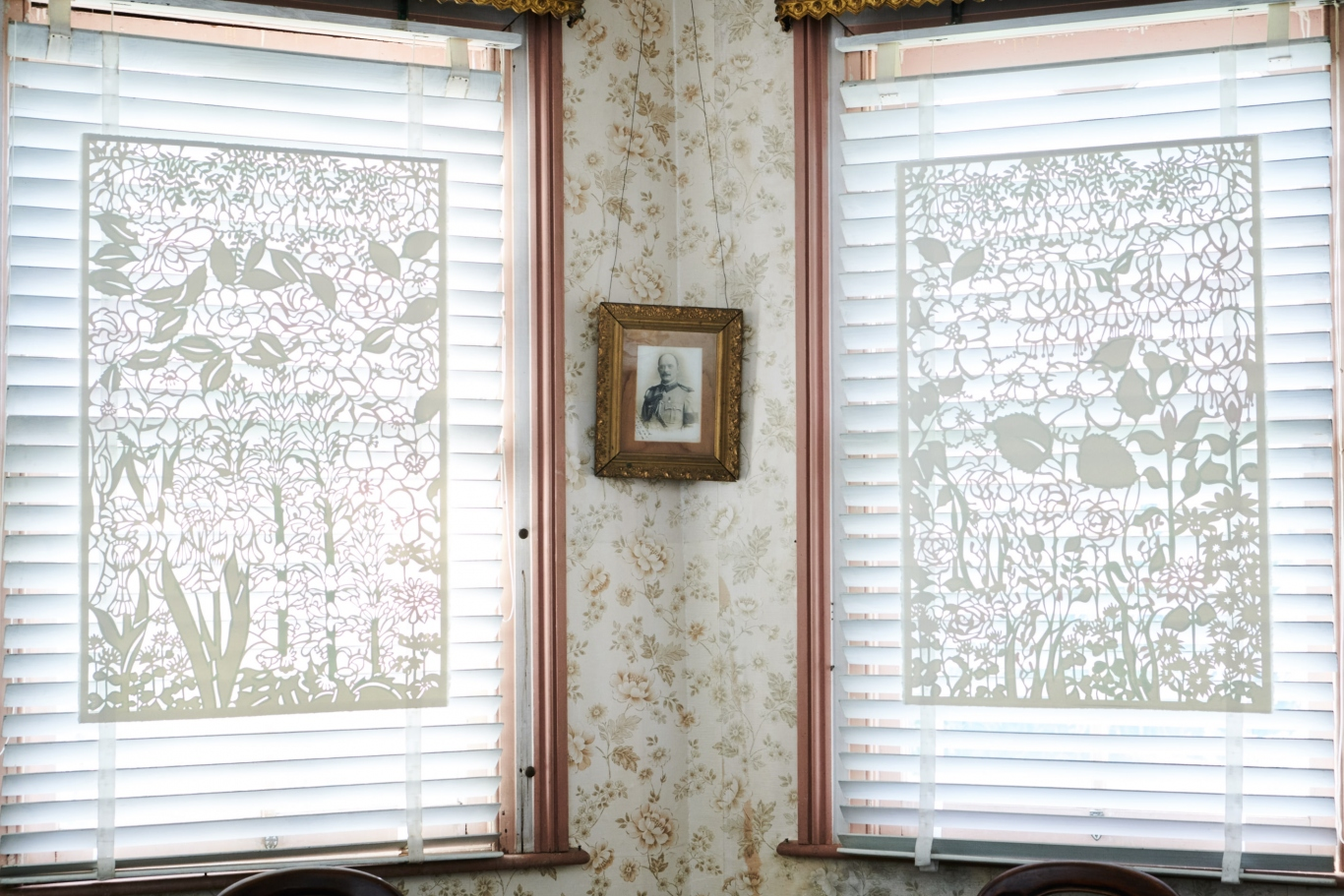 Install view of Lee Bethel, 'The Garden's Curtain', watercolour on hand cut paper