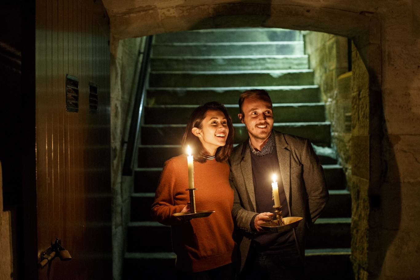 Man and a woman holding candles