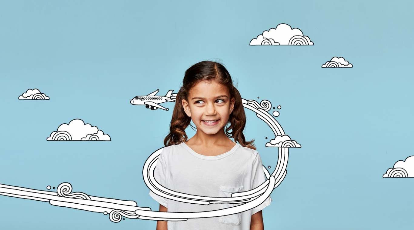 Girl looking right as cartoon aeroplane flies around her head.