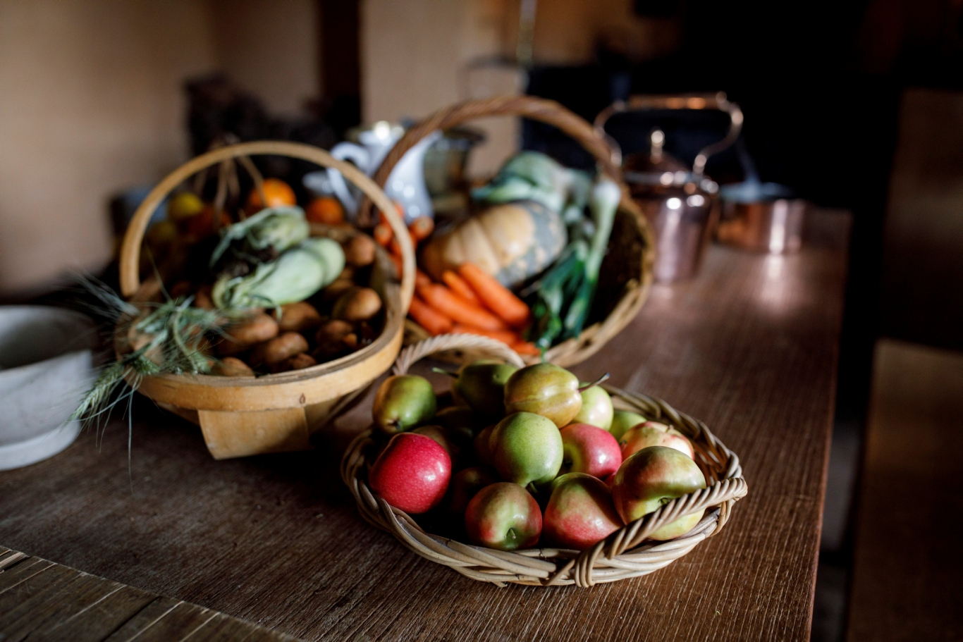 Vegetables and fruit on kitchen table.