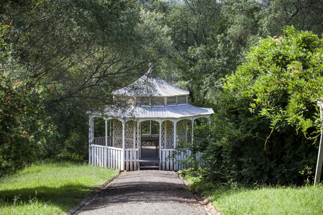 White gazebo in rural setting.