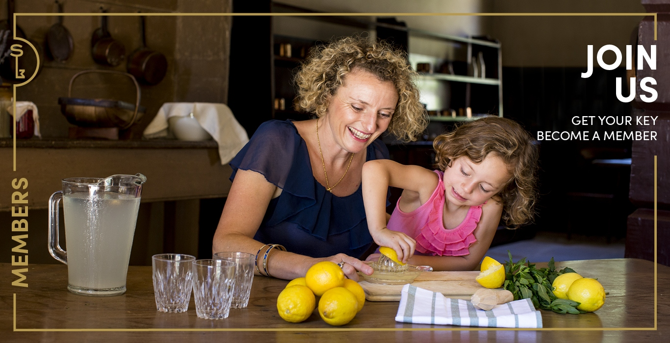 Hero image for SLM membership: woman with child squeezing lemons in kitchen overlaid with words: Join us