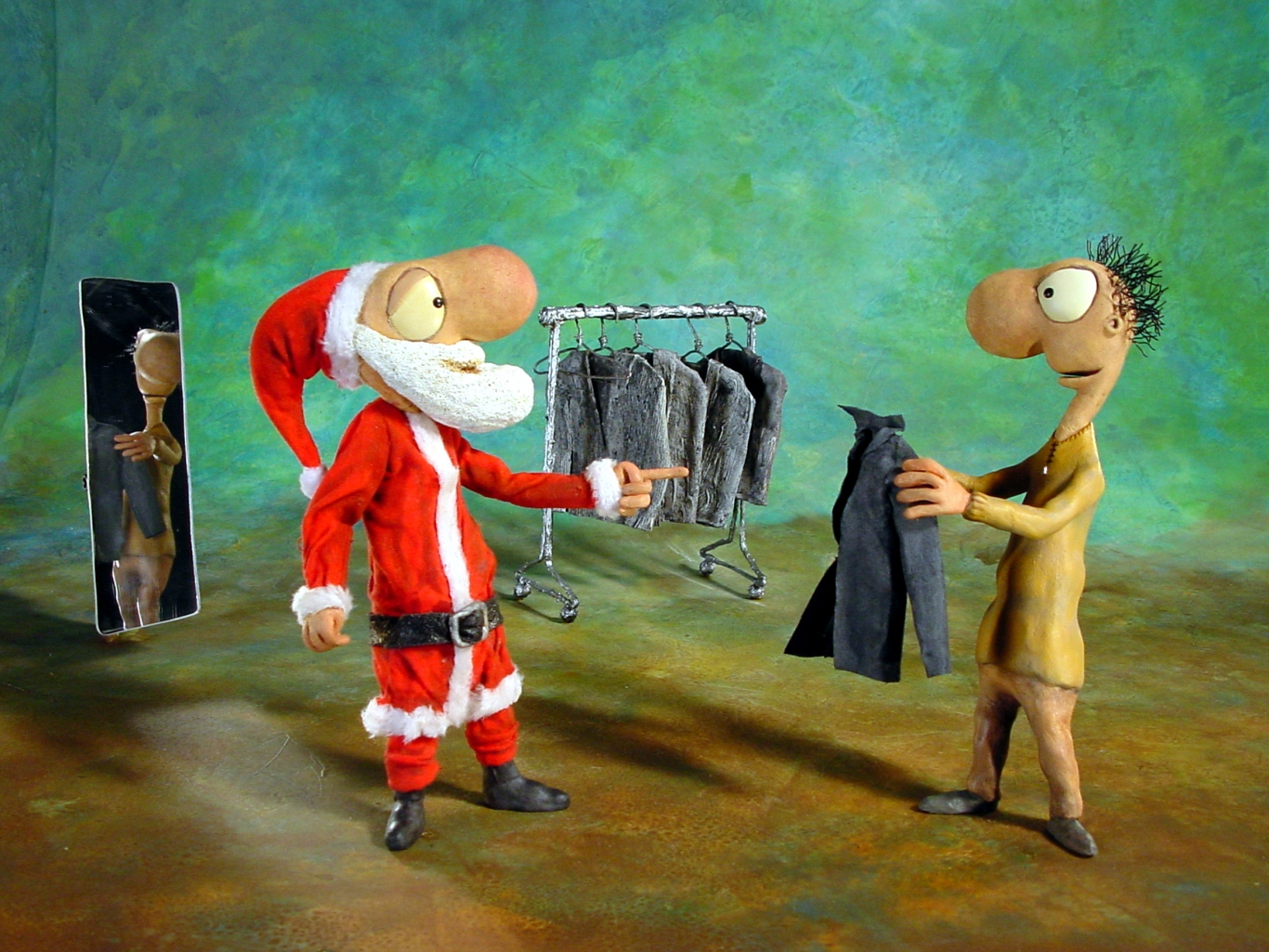 A slim Leunig style santa clause stands in front of a man holding up a jacket to try on