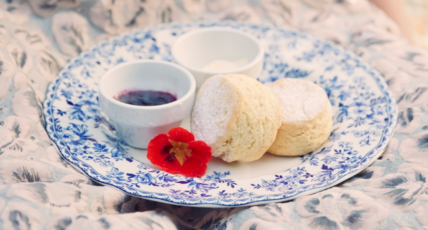 Patterned plate with scones and accompaniments