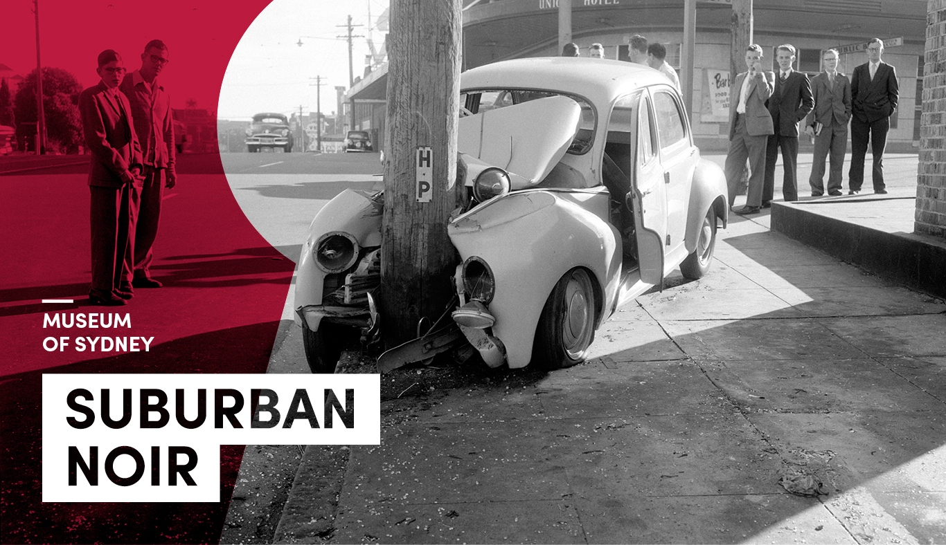 Old black and white photo of a car accident. A car has run into a power poll and is severely stoved in and damaged. Men stand by. Text says Suburban Noir with Museum of Sydney in smal type
