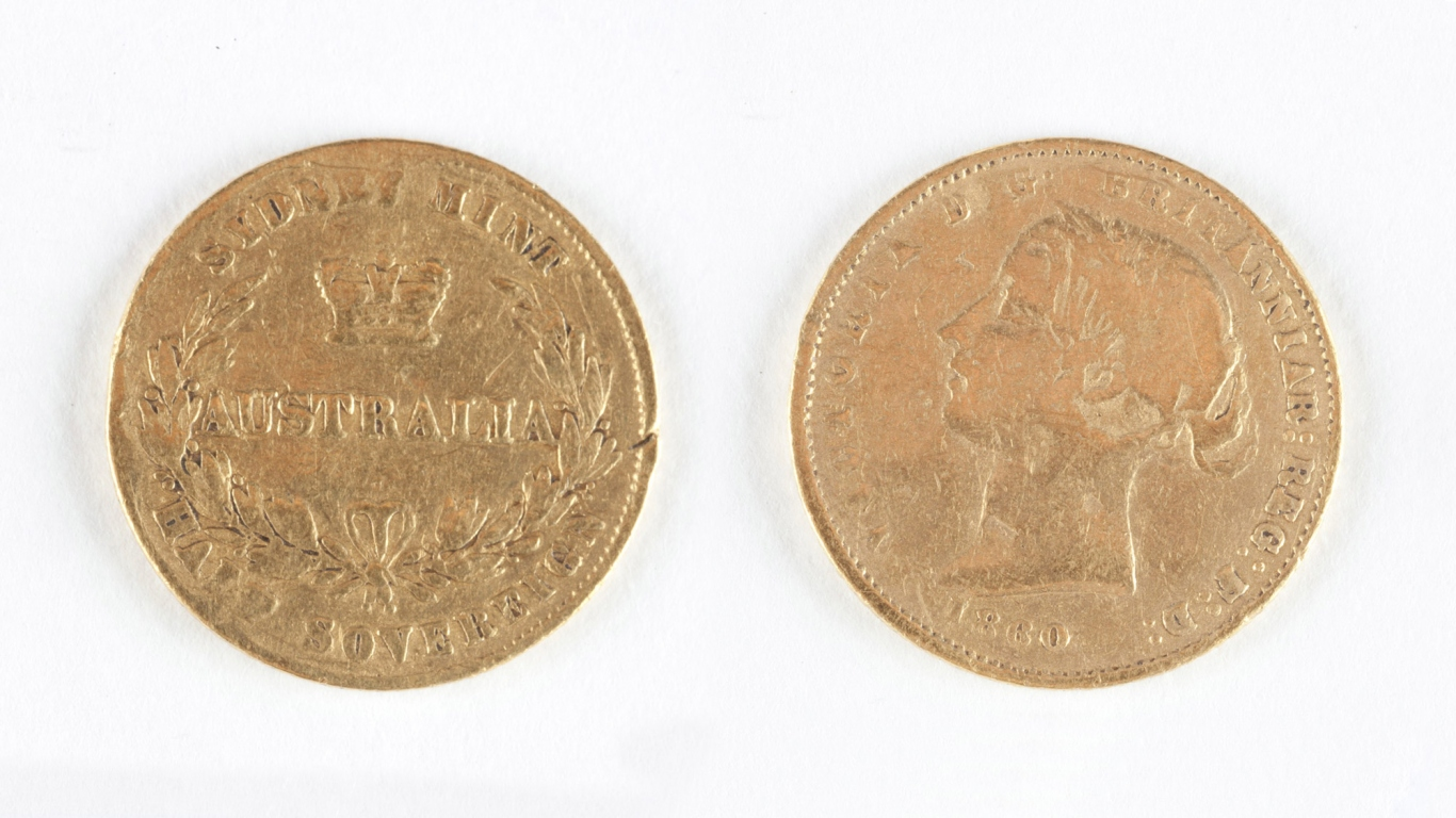 Front and back of gold coin, showing details of inscription. Embossed text obverse side of coin; 'VICTORIA D:G: BRITANNIAR: REGINA F:D: 1860'. Embossed text reverse of coin; 'SYDNEY MINT / AUSTRALIA / HALF SOVEREIGN'.