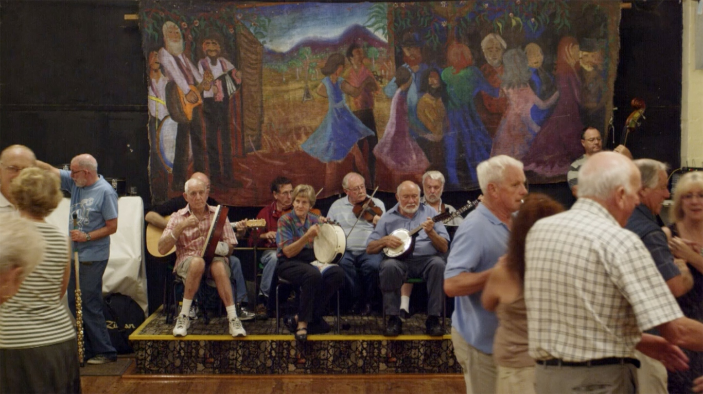 Large groups of people playing musical instruments and dancing