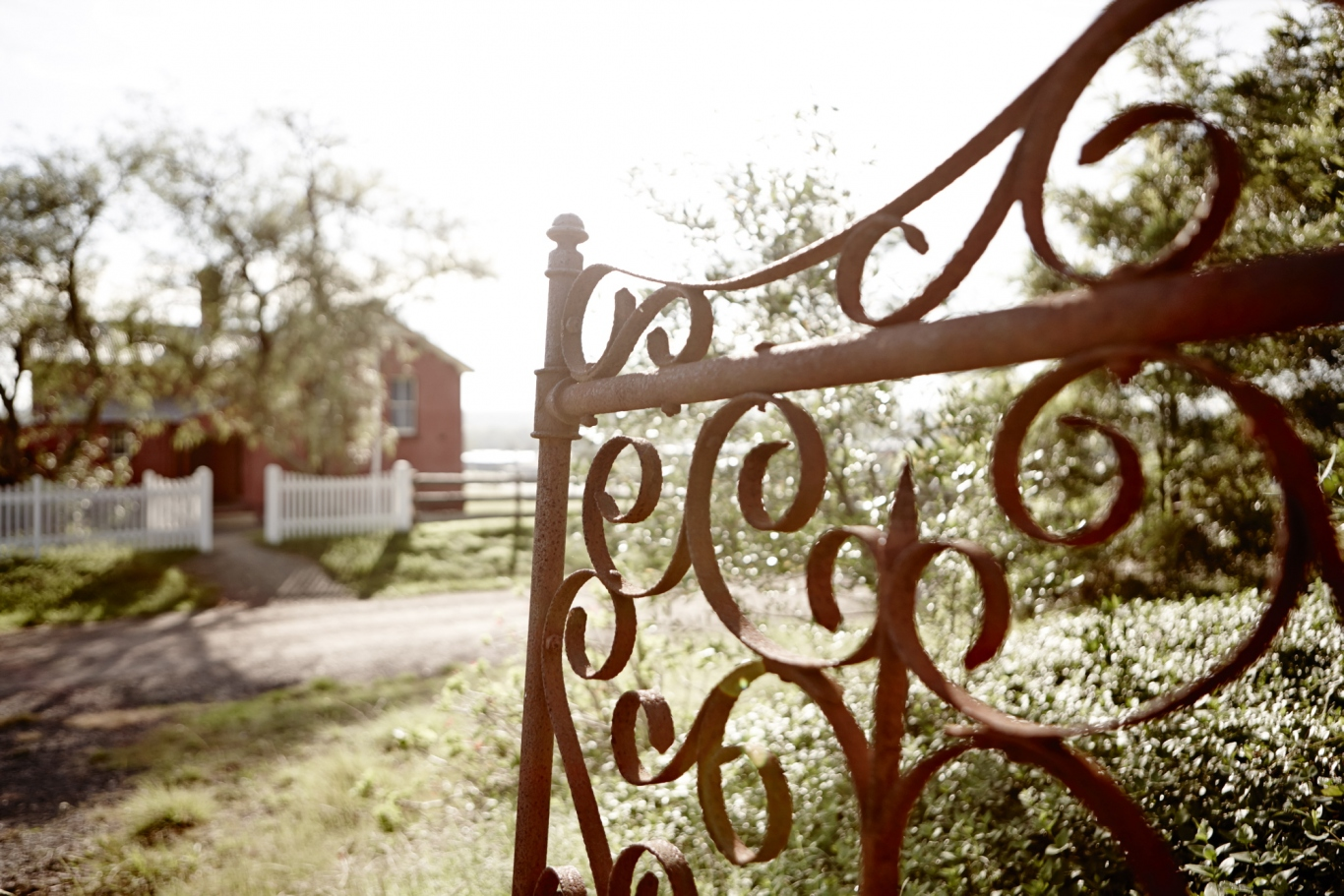 View through gate towards the old schoolhouse, Rouse Hill House and Farm