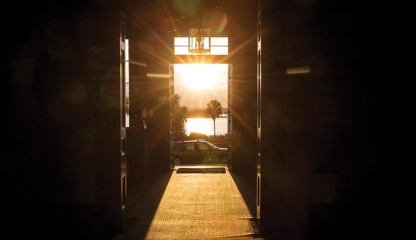 View of rising sun through the door at Elizabeth Bay House